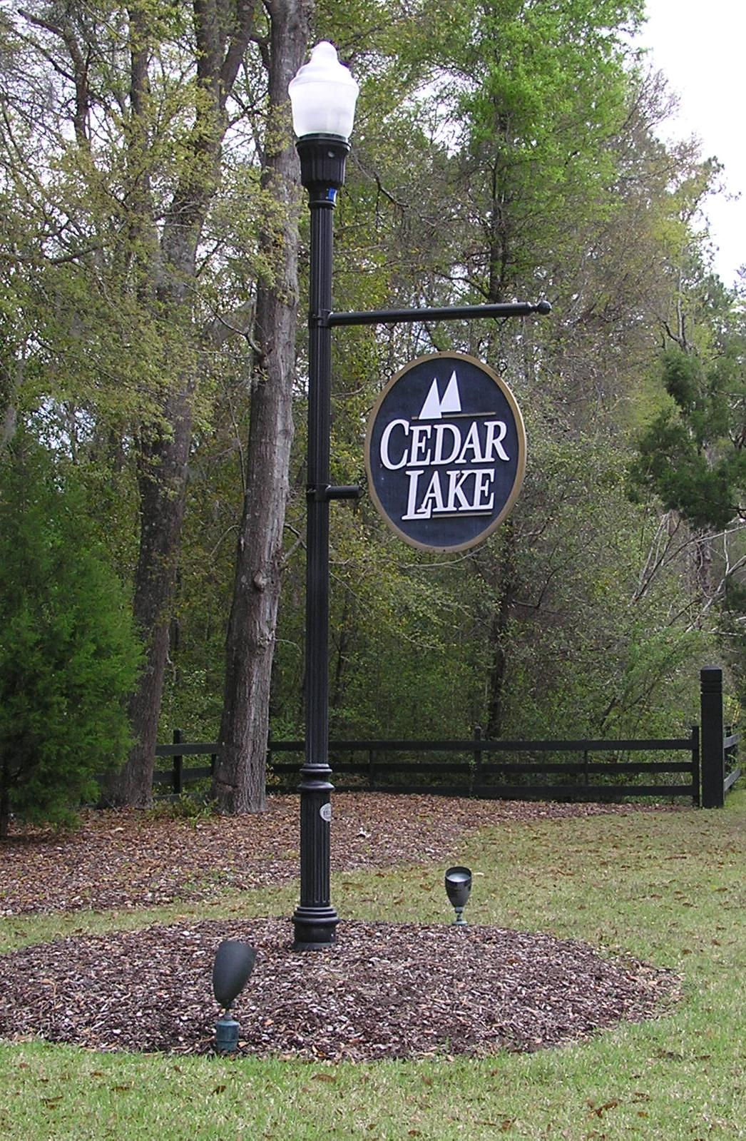 The Entrance Sign For The Neighborhood